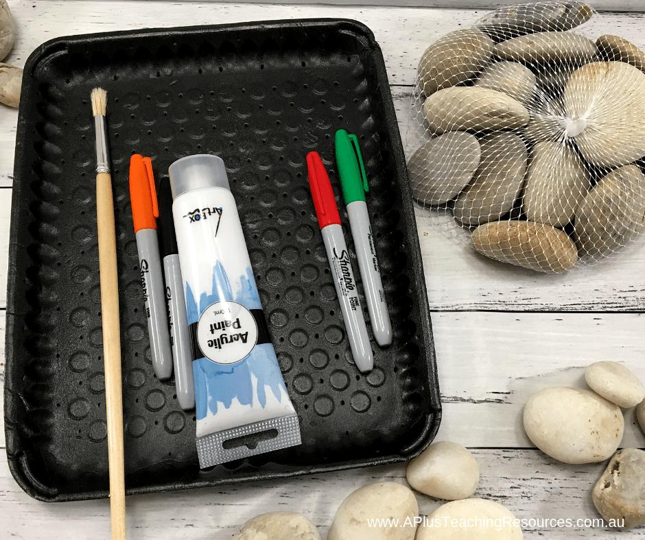 Painted Snowman rocks equipment