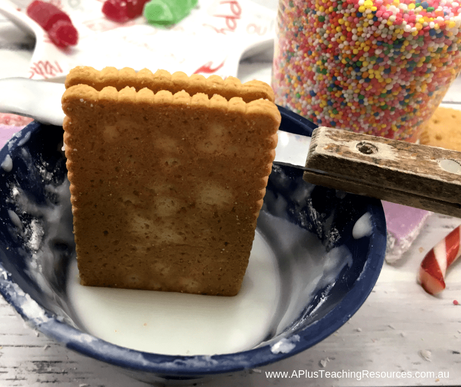 decorate the base of the gingerbread house