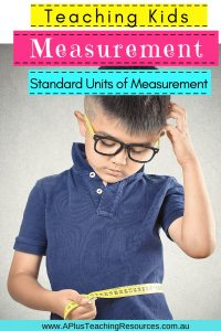 Teaching Standard Measurement boy using a tape measure to measure his waist